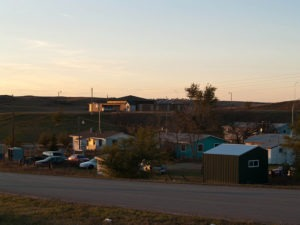 Photo by Andrew Filer - Activists from North Dakota's reservation town of Mandaree, which is mostly poor, say none of the oil money collected by either the tribe or the state of North Dakota comes back to their town.