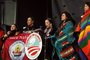 Tribal members onstage at anti–Keystone XL and climate change rally on February 17, 2013, left to right: Patricia Shepard (Ojibwe, Wisconsin), Casey Camp (Ponca, Oklahoma), Crystal Lameman (Beaver Lake Cree, Alberta, Canada), Melina Laboucan-Massimo (Lubicon Cree, Northern Alberta, Canada) and Kandi Mossett (Mandan, Hidatsa, Arikara Photo Credit: Jenna Pope