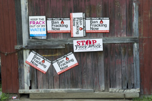 Signs protest fracking on the side of a barn in Pennsylvania.Credit: Melanie Blanding