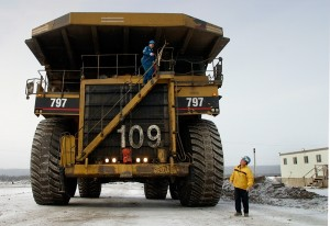 Heavy equipment operators at an oil sands mine near Fort McMurray, Alberta, Canada. Photo Credit: Jerry Cleveland / The Denver Post